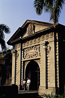 Philippines,Manila,Couple Walking Through Puerta del Parian, one of the Entrances to the Intramuros Historical District - Travelasia