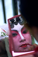 China,Hong Kong,Portrait of Chinese Opera Actress Applying Make-up - Travelasia