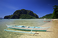 Philippines,Palawan,Bascuit Bay,El Nido,Outrigger on Tropical Beach at Sunset - Travelasia