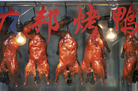 China,Shanghai,Roast Duck Hanging in Restaurant Window - Travelasia