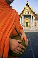 Thailand,Bangkok,Marble Temple,Wat Benchamabophit,Monk Holding Alms Bowl - Travelasia