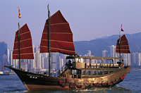 China,Hong Kong,Victoria Harbour,Junk and City Skyline in Background - Travelasia