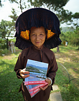 China,Hong Kong,New Territories,Hakka Woman at the Kam Tin Walled Village - Travelasia