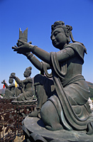 China,Hong Kong,Lantau,Chinese Goddess Statues at the Base of The Giant Buddha Statue at Po Lin Monastery - Travelasia