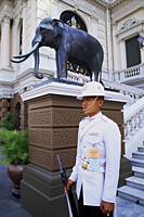 Thailand,Bangkok,Wat Phra Kaeo,Grand Palace,Guard at the Royal Palace - Travelasia