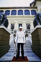 Thailand,Bangkok,Wat Phra Kaeo,Grand Palace,Guard at the Royal Palace - Travelasia