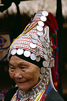 Thailand,Chiang Rai,Akha Hilltribe Woman Wearing Traditional Silver Headpiece - Travelasia