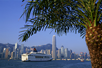 China,Hong Kong,Cruise Boat and City Skyline - Travelasia