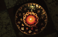 Top view of candle in bronze bowl - Alex Mares-Manton