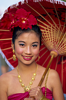 Thailand,Chiang Mai,Portrait of Girl in Traditional Thai Costume at the Chiang Mai Flower Festival - Travelasia