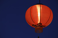 Red lantern glowing at night - Alex Mares-Manton