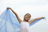 young girl holding blue cloth smiling - Yukmin