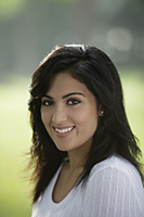 Head shot of young Indian woman smiling - Alex Mares-Manton