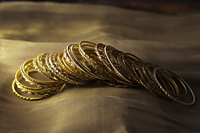 Gold bangles on gold sari - Alex Mares-Manton