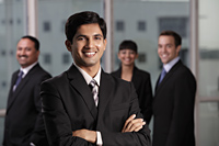 Indian man smiling in front of his colleagues - Alex Mares-Manton