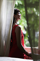 Indian woman looking out window - Alex Mares-Manton