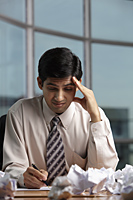 Indian man stressed at work - Alex Mares-Manton