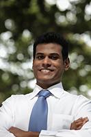 Indian man looking at camera and smiling - Alex Mares-Manton