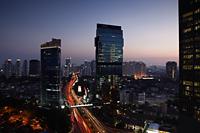 Evening view of CBD and skyscrapers along Jalan Jend Sudirman, Jakarta - Martin Westlake