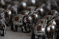 Elephant figurines decorated with mirrors and beads - Alex Mares-Manton