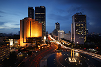 Night view of Hotel Indonesia roundabout, Welcome Monument and buildings along Jalan Thamrin, Jakarta - Martin Westlake
