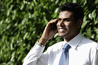 Cropped shot of  Indian man talking on phone and smiling - Alex Mares-Manton