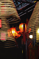 Red lanterns with incense coils in foreground - Alex Mares-Manton