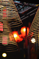 Incense coils with red lanterns in background - Alex Mares-Manton
