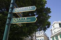 Sign post in Macau - Alex Mares-Manton