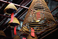 Incense coils hanging from temple ceiling. - Alex Mares-Manton