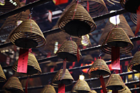 Incense coils hanging from ceiling. Man Mo Temple, Hong Kong - Alex Mares-Manton