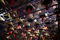 Incense coils hanging from ceiling of Man Mo Temple, Hong Kong - Alex Mares-Manton