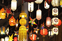 Assortment of different lanterns glowing at night - Alex Mares-Manton