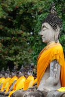 Side view of stone Buddhas at Wat Yai Chaya Mongkol Temple, Thailand - Alex Mares-Manton