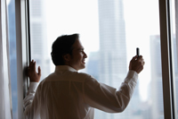 profile of businessman taking a photo with phone - Yukmin