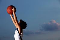 profile shot of young boy catching basketball - Yukmin