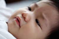 head shot of sleepy baby - Yukmin