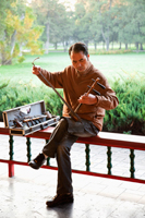 China,Beijing,Temple of Heaven Park,Man Playing Erdu Traditional Stringed Instrument - Travelasia