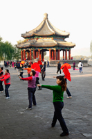 China,Beijing,Summer Palace Park,Woman Exercising with fans - Travelasia