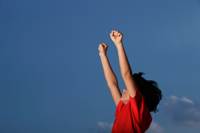 Young boy with red shirt with hands outstretched - Yukmin