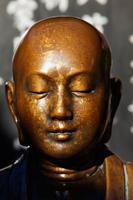 Bronze head of Buddha statue. Asakusa Kannon Temple, Japan - Travelasia