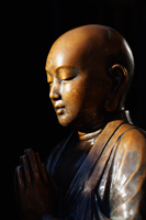Profile of bronze Buddhist statue praying. Asakusa Kannon Temple, - Travelasia