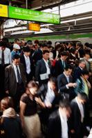 Commuter Crowds at Shinjuku Railway Station. Japan - Travelasia