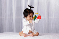 Chinese baby looking at toy key ring - Yukmin