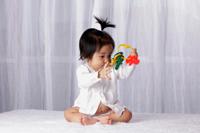 Chinese baby looking at toy key ring - Yukmin