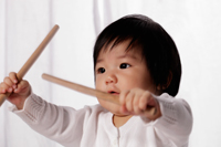 Chinese baby holding drum sticks - Yukmin