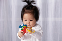 Chinese baby holding toy key ring - Yukmin
