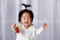 Chinese baby smiling with eyes closed - Yukmin