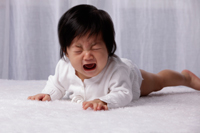 Chinese baby on tummy crying - Yukmin