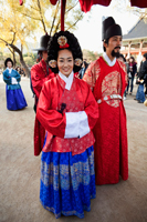 Re-emactment of the King and Queen strolling through the Palace grounds. Seoul, Korea - Travelasia